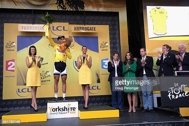 Overall race leader Marcel Kittel of Germany and Team Giant-Shimano is presented takes the podium as Prince Harry, Catherine, Duchess of Cambridge...