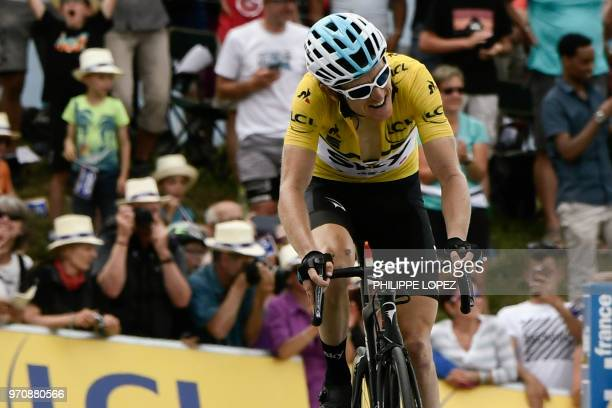 Overall race winner, Britain's Geraint Thomas, wearing the overall leader's yellow jersey, crosses the finish line to place 5th of the seventh and...