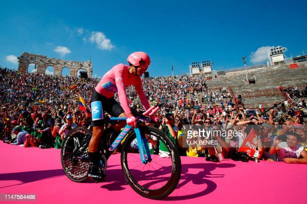 Overall race winner Team Movistar rider Ecuador's Richard Carapaz reacts as he enters the arena after competing in stage twenty-one, the final stage...