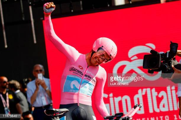 Overall race winner Team Movistar rider Ecuador's Richard Carapaz reacts after competing in stage twenty-one, the final stage of the 102nd Giro...