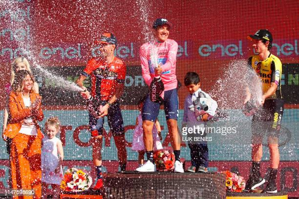 Overall race winner Team Movistar rider Ecuador's Richard Carapaz , overall second-placed Team Bahrain rider Italy's Vincenzo Nibali and overall...