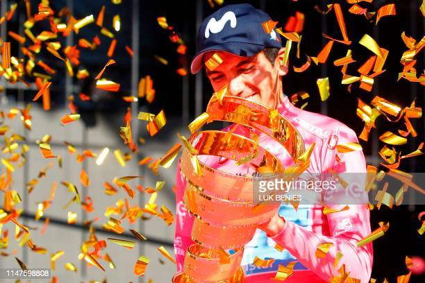 """Overall race winner Team Movistar rider Ecuador's Richard Carapaz holds the """"Never ending trophy"""" during podium ceremonies in the Verona arena, after..."""
