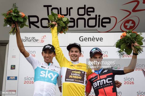 Overall secondplaced Colombia's Egan Arley Bernal Gomez of Team Sky overall race winner Slovenia's Primoz Roglic of Lotto NLJumbo team and overall...