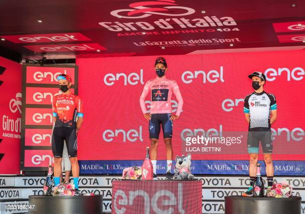 Overall second-placed Team Bahrain rider Italy's Damiano Caruso, Giro d'Italia 2021 winner Team Ineos rider Colombia's Egan Bernal and third-placed...