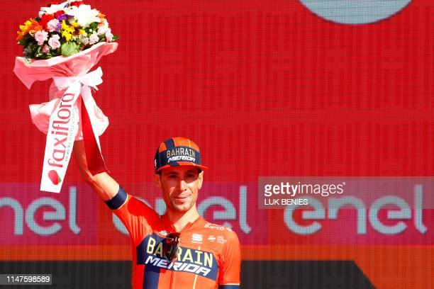Overall second-placed Team Bahrain rider Italy's Vincenzo Nibali celebrates on the podium after stage twenty-one, the final stage of the 102nd Giro...
