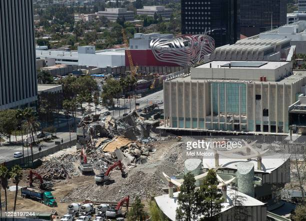 Overall, shows the Art of the Americas Building at the Los Angeles County Museum of Art in Los Angeles being demolished. Demolition will clear space...