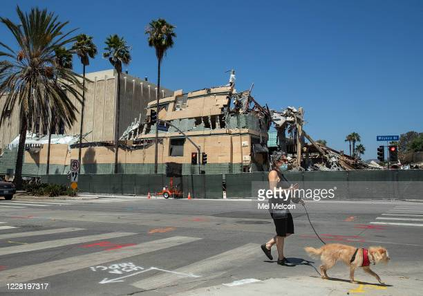 Overall, shows the Art of the Americas Building at the Los Angeles County Museum of Art in Los Angeles being demolished, as seen from Wilshire Blvd....