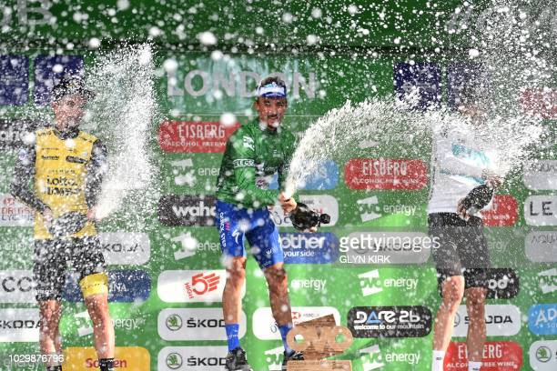 Overall third placed rider Slovenia's Primoz Roglic riding for Team Lotto NI Jumbo winner France's Julian Alaphilippe riding for Quick Step Floors...