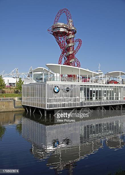 Overall view across water with The Arcelormittal Orbit in background BMW Group Pavilion London 2012 Showroom Europe United Kingdom Serie Architects