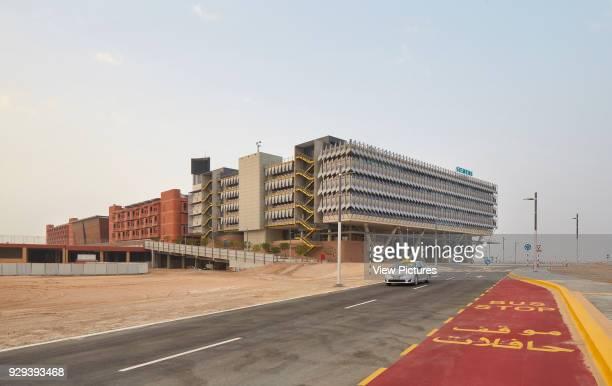 Overall view from street. Siemens Masdar, Abu Dhabi, United Arab Emirates. Architect: Sheppard Robson, 2014.