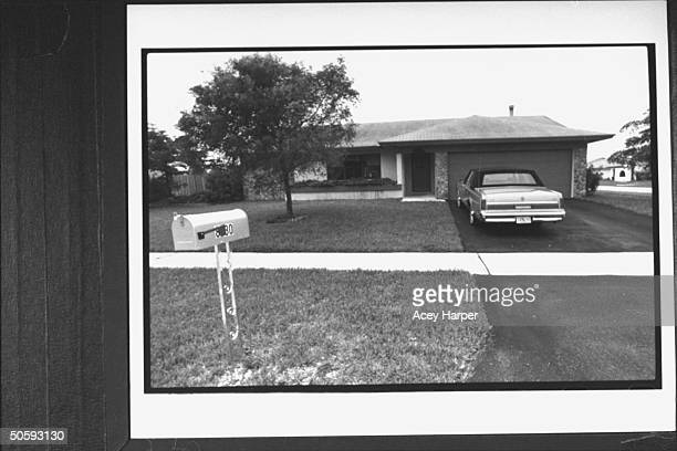 Overall view of house car in driveway of alleged prostitute Kathy Willets where she engaged in sexual encounters arranged by her sheriff's deputy...