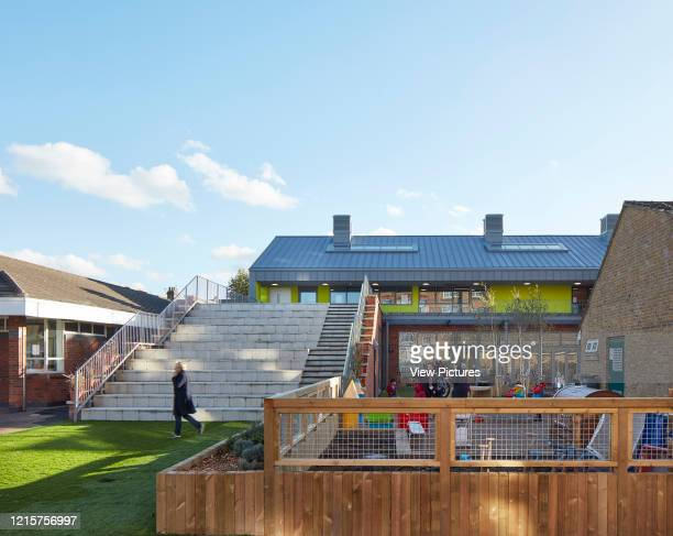 Overall view of playground and exterior stairway. Sandringham Primary School, London, United Kingdom. Architect: Walters and Cohen Ltd, 2017..