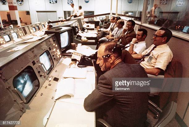 Overall view of some of the console activity in the Mission Operations Control Room in the Mission Control Center Building 30 during the Apollo 11...