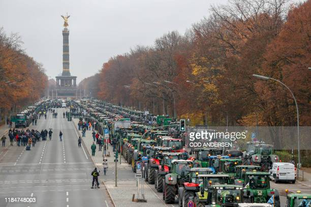 Overall view shows hundreds of farmers lining up with their tractors near the Victoty Column during a protest on November 26 2019 in Berlin against...