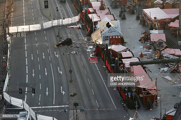 TOPSHOT Overall view shows the area of the Christmas market area and the destroyed booths targeted by an attack with a truck two days ago in front of...