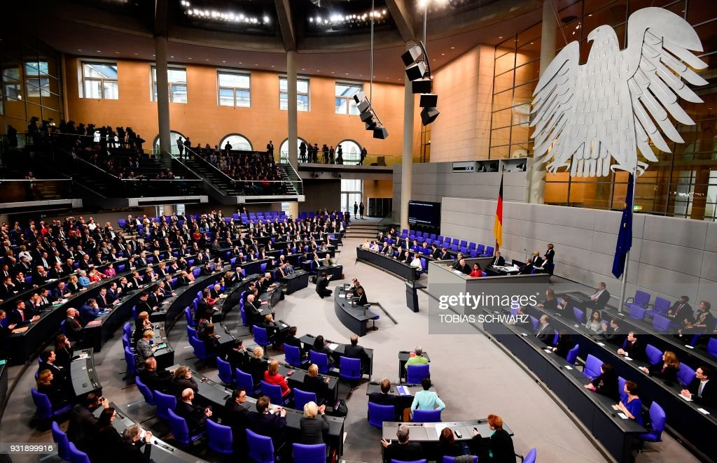 Overall view shows the Bundestag plenum after German Chancellor Angela Merkel and her cabinet members were sworn in and have taken their seats on the government's bench (background) during a session at the Bundestag (lower house of parliament) on March 14, 2018 in Berlin. Chancellor Angela Merkel, bruised by half a year of post-election coalition haggling, was narrowly confirmed by parliament to her fourth and likely final term at the helm of Europe's biggest economy. / AFP PHOTO / Tobias SCHWARZ