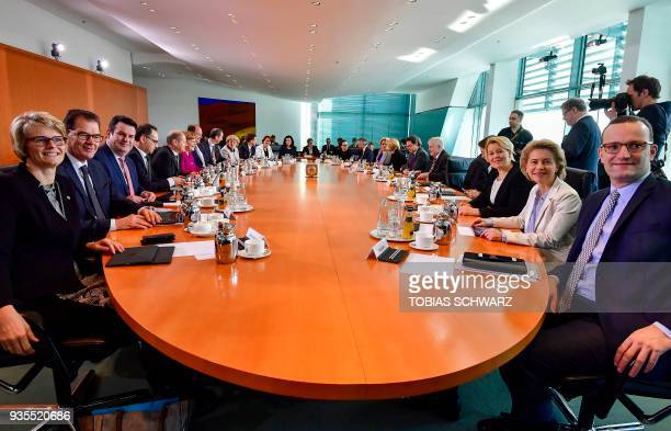 Overall view shows the members of the German cabinet sitting around the table before the second weekly cabinet meeting of the new government on March...