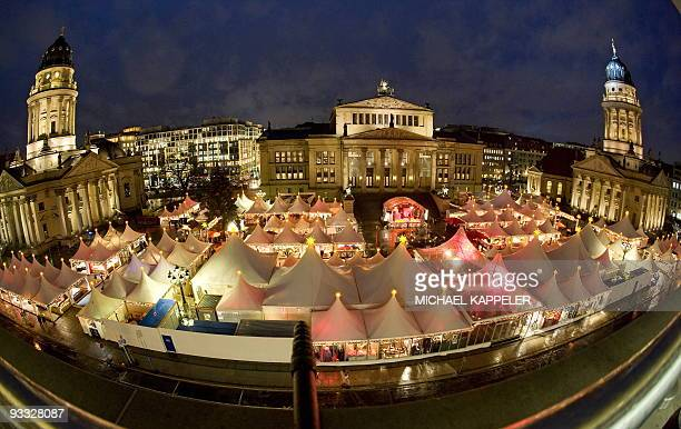 Overall view taken on November 23 2009 shows the Christmas market on Berlin's central Gendarmenmarkt place between the Deutscher Dom the Konzerthaus...