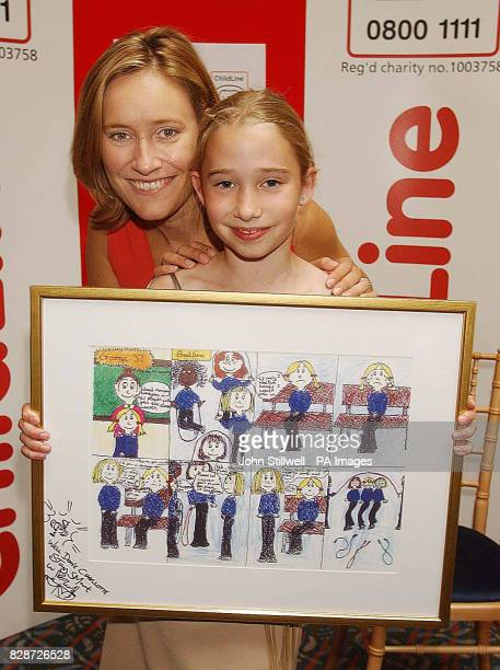 Overall winner Charlotte Pegg from Ladysmith Middle School in Exeter Devon with BBC TV news presenter Sophie Raworth and her award winning cartoon...
