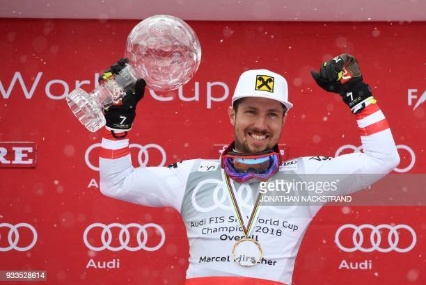 Overall Winner of the Men's Alpine Skiing World Cup Marcel Hirscher of Austria celebrates on the podium in Aare Sweden on March 18 2018 / AFP PHOTO /...