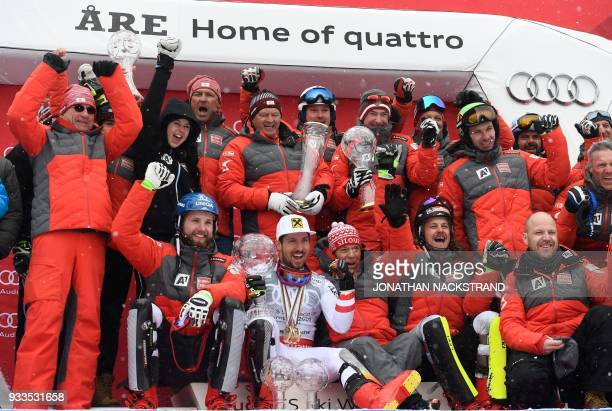 Overall Winner of the Men's Alpine Skiing World Cup Marcel Hirscher and members of team Austria celebrate on the podium with all their trophies after...