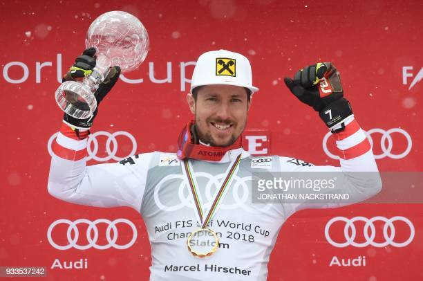 Overall winner of the Men's Slalom discipline of the Alpine Skiing World Cup Marcel Hirscher of Austria celebrates on the podium in Aare Sweden on...