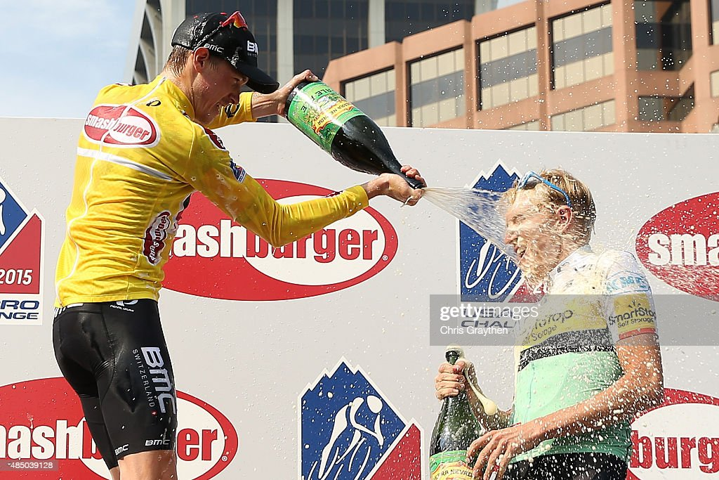 Overall Winner Rohan Dennis of Australia riding for BMC Racing and third place overall Rob Britton of United States riding for Team SmartStop celebrate with champagne following stage seven from Golden to Denver of the 2015 USA Pro Challenge on August 23, 2015 in Denver, Colorado.