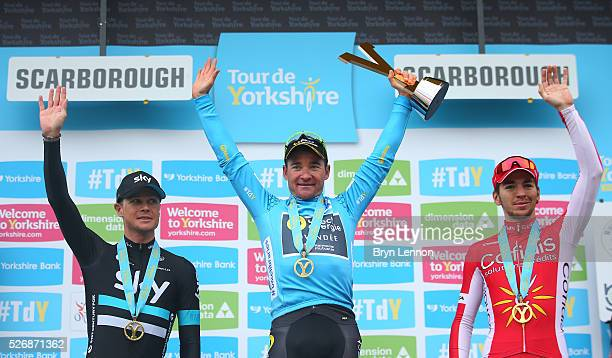 Overall winner Thomas Voeckler of Direct Energie and France celebrates with Nicolas Roche of Team Sky and Ireland and Anthony Turgis of Cofidis,...