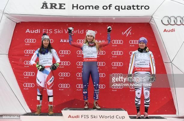 Overall winners of the Women's Alpine Skiing World Cup celebrate on the podium Wendy Holdener of Switzerland Mikaela Shiffrin of the US and Viktoria...