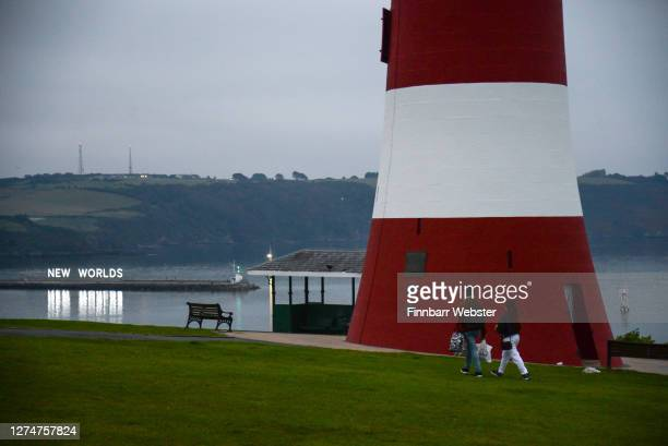 Overcast and misty conditions at Smeaton's Tower as day breaks on the first day of autumn at Plymouth Hoe with the backdrop of the Mayflower 400th...