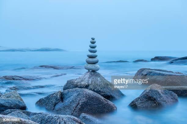Overcast balanced stones