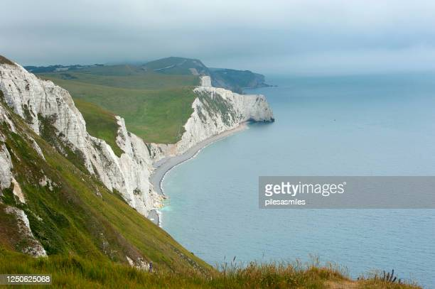 overcast clifftop, osmington mills, ringstead bay, jurassic coast, dorset, england - weymouth dorset stock pictures, royalty-free photos & images