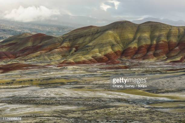 overcast colors - painted hills stock pictures, royalty-free photos & images