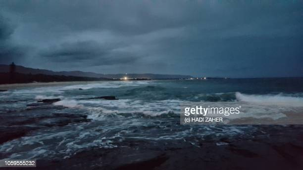overcast evening at wollongong beach | australia - wollongong stock pictures, royalty-free photos & images