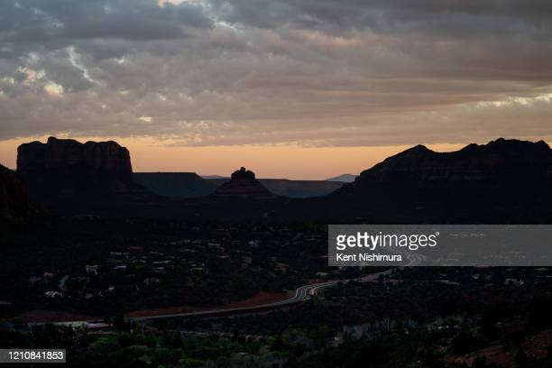 Overcast skies are seen over Sedona as the sunsets over the Verde Valley region as people watch the sunset from atop of the summit of the Airport...