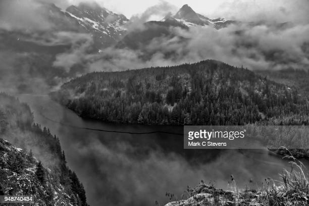 overcast skies over mountains and diablo lake - pinnacle peak stock pictures, royalty-free photos & images