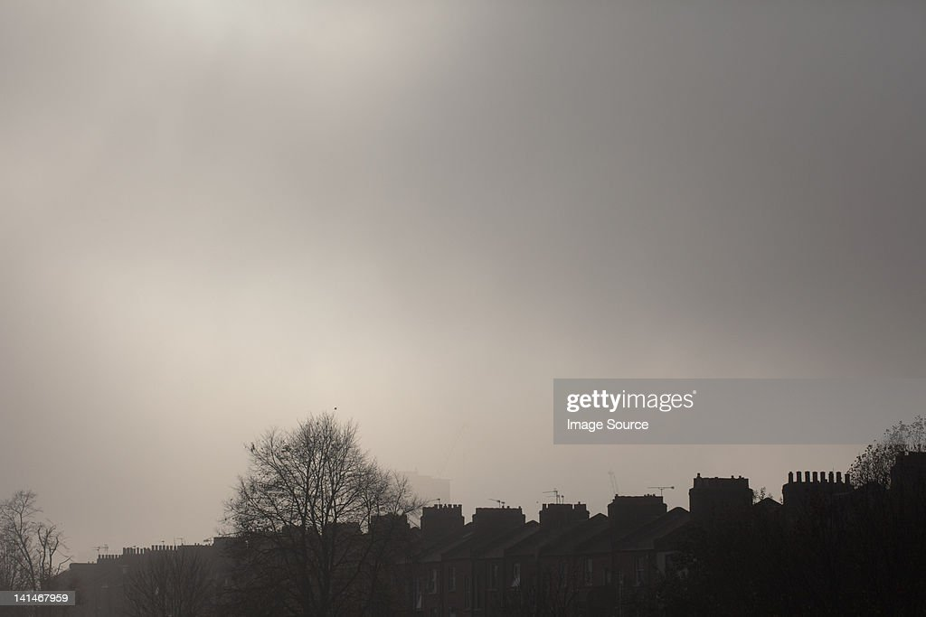 Overcast sky above terraced houses : Stock Photo