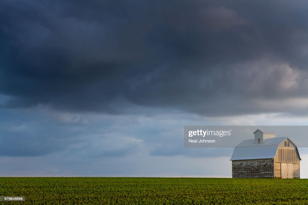 Overcast sky over barn, Cedar Falls, Iowa, USA : Stock Photo