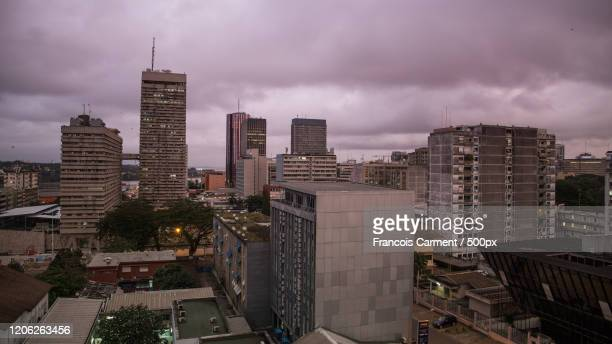 overcast sky over city, la plateau, abidjan, cote divoire - abidjan bildbanksfoton och bilder