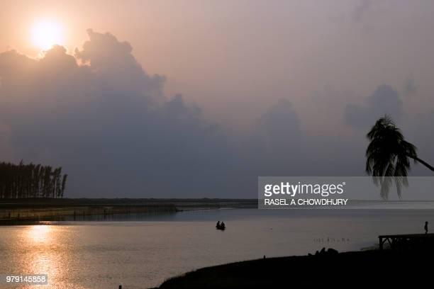 overcast sky over river, coxs bazaar, bangladesh - coxs bazaar stock photos and pictures