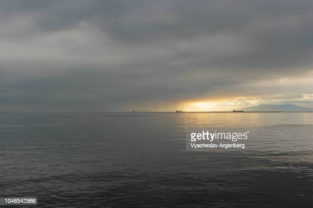 overcast sky with heavy clouds, manila bay, philippines - argenberg stock pictures, royalty-free photos & images