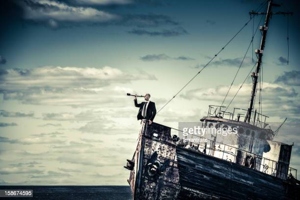 overcome the economic crisis - team captain stock pictures, royalty-free photos & images