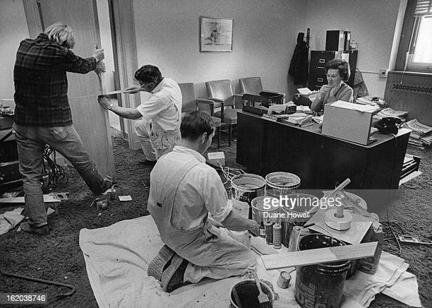 DEC 11 1974 DEC 12 1974 Overcoming Distractions Workmen mixing paint and fitting a door in the former office of the lieutenant governor in the State...