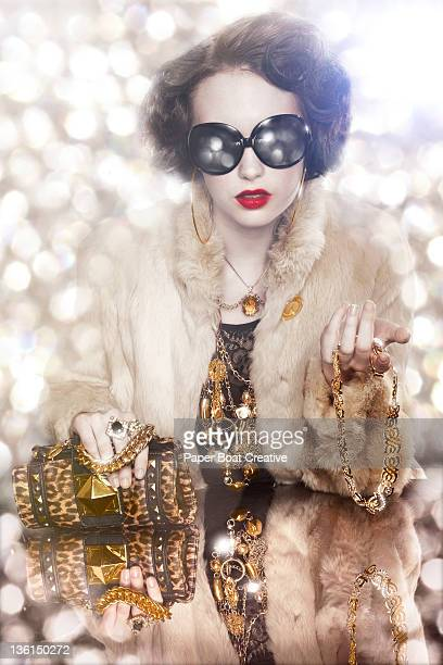 over-dressed glamorous lady with gold chains - millionnaire stock photos and pictures