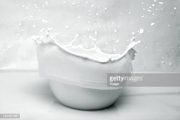 Overflow of milk in a bowl