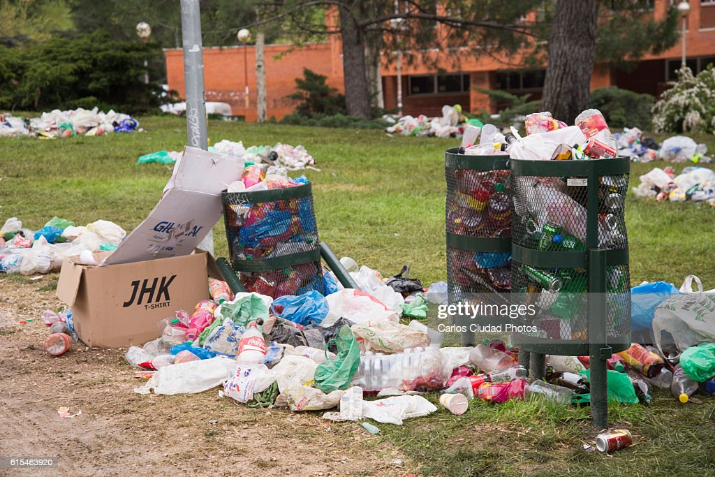 Overflowing bins in a park of Ciudad Universitaria, Madrid : Stock Photo