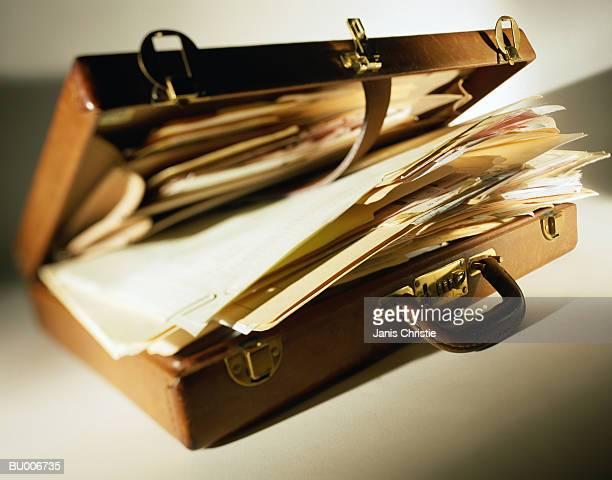 Overflowing Briefcase
