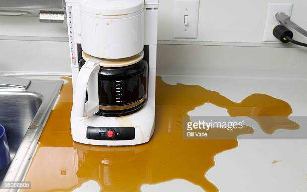 overflowing coffee maker - coffee maker stock pictures, royalty-free photos & images