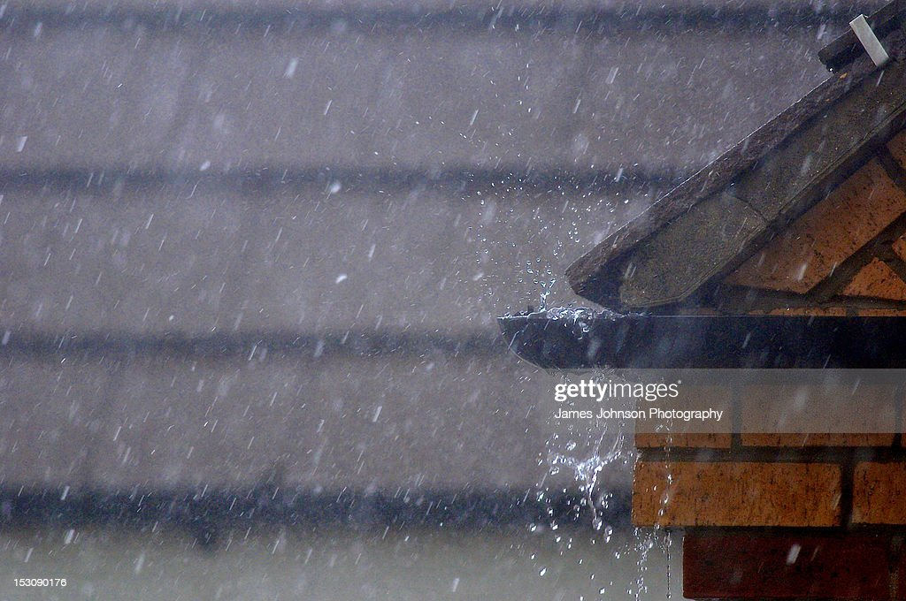 Overflowing guttering due to flood : Stock Photo
