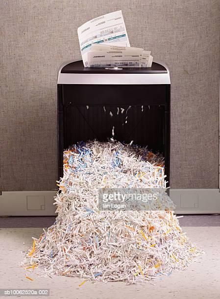 Overflowing paper shredder